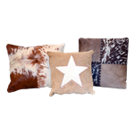Cluster of (3) Cowhide Pillows
